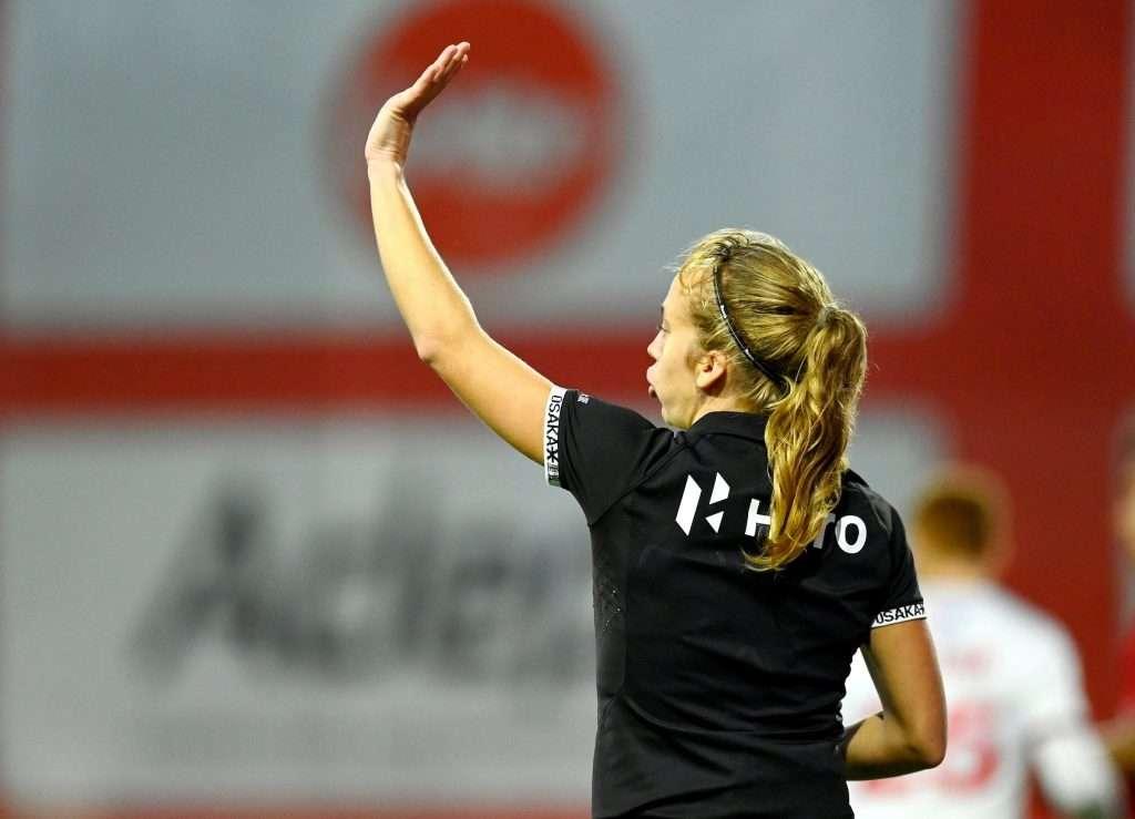 Belgian Umpire Delforge umpiring Belgium v Great Britain women