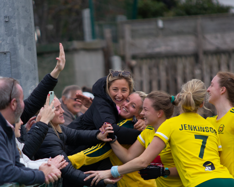 Railwau Unions Kate Dillon and her team mates celebrate with fans after their shoot out win Pic Max Fulham